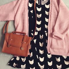 cute black and white cat dress, pink knit cardigan and brown bag