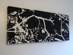 White tree branches on black Wall Art fabric wrapped frame wall decor wall hanging. $55.00, via Etsy.
