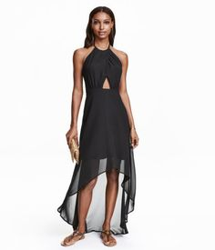 $69 Halterneck dress in airy chiffon. Wrapover front with concealed snap fastener. Open back with hook-and-eye fastener at back of neck. Boning at sides and concealed side zip. Knee-length at front and longer at back. Lined.