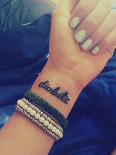 I really want this tattoo. I know that I'll be judged by some of my friends for saying this but. I hate the stupid bracelets.