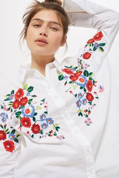 Long sleeve embroidered poplin shirt.