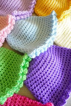 I was drawn immediately to this picture with colorful, beautiful crochet baby hats! They seem so happy and playful!