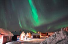 Santa Claus Holiday Village under northern lights