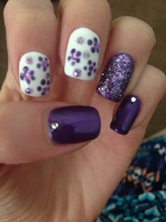 Purple dotted flowers on white polish, purple glitter accent nail, purple polish with silver rhinestone