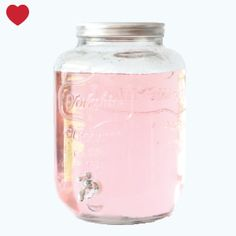 Pretty vintage drink dispenser with pink lemonade. Could add in some lemon and lime pieces too. Mason Jar Dispenser, Drink Dispenser, Infused Vodka, Infused Water, Cosy Kitchen, Yogurt Shop, Glass Milk Bottles, Vintage Party, Mason Jars
