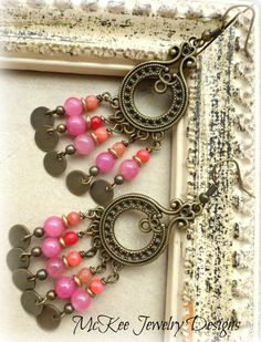 Ruffles. Pink stones, bronze round charms and bronze metal bohemian earrings.
