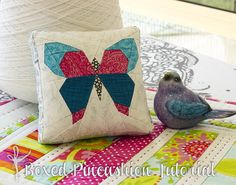 Boxed Pincushion Tutorial @ Arabesque Scissors - also link to free FPP butterfly pattern by lillyella