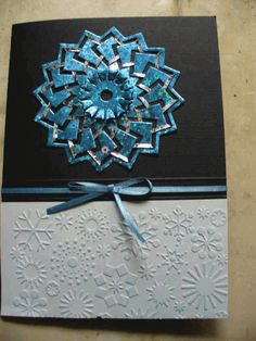 Karen created this lovely Wintery card using Spellbinders Cut, Fold & Tuck die- Spectacular Spin- She used the Cuttlebug Snowflake (a2 size) Embossing folder for the Snowflake border- Dies and Embossing folders are in stock- to order, or for information, email: integritydes at telus dot net
