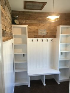 This is our mud room. Ship lap walls and pallet wood top. The light was made from a old chicken feeder. Also a stained concrete floor with clear coat.