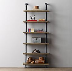 RH Baby & Child's Industrial Pipe Shelving:Sturdy steel pipes and matching cast fittings serve as the structure for our hardworking pieces, while warm wood planks provide support for books and a workspace for the industrious. Industrial Bakers Racks, Industrial Pipe Shelves, Rustic Shelves, Wood Shelves, Galvanized Pipe Shelves, Plumbing Pipe Shelves, Industrial Metal, Industrial Style, Pipe Bookshelf
