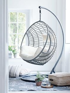 Elegant Design of The Indoor Swing Chair with Silver Color Ideas Added with White Fabric Seat