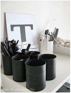 Tin cans spray painted with some color make classy pencil holders.
