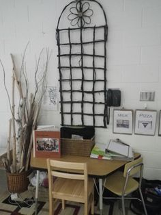 The Welcome Table: This area of the classroom is near the front door. Parents can find information about their children and the school on the table. The picture frame is for family photos and the children are responsible for keeping their communication bags in the wicker basket. http://pinterest.com/kinderooacademy/provocations-inspiring-classrooms/