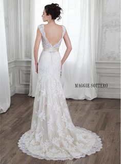 Dreamy lace and tulle make up this gorgeous wedding gown, Shayla by Maggie Sottero.