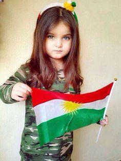 Kurdish bwby with kurdistan flag and peshmerge clothes