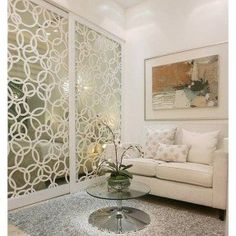 This is a cool thing - maybe we could do something like this vinyls. Who's the Fairest of Them All? 9 Ways to Decorate With Mirrors: The pattern helps these mirrored walls appear more incognito but still reflects plenty of light. Separation Studio, Diy Closet Doors, Deco Studio, Ikea, Room Divider Doors, Room Dividers, Room Decor, Wall Decor, Diy Wall