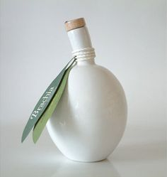 nontraditional label/tag with string, cool idea using the shape of olive leaves for the shape of the label.
