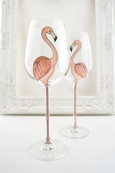 These lovely, wine glasses are made from high quality, lead free crystal with a laser-cut rim, a long, elegant stem and generous bowl that holds up to 405ml. From base to rim, it stands 25cm tall and the stem alone is 12cm - perfect for those long flamingo legs... The flamingos are hand painted on, one on each glass, when sold in pairs, so that they face one another. Please note - these glasses are available to buy singly or as a pair - please make your selection from the drop down box. If…