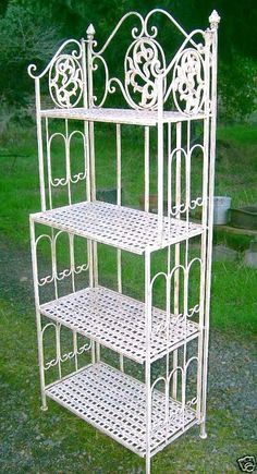 french country cottage white ivory folding ornate iron metal iron bakers rack shelves stand pinecones plant stand iron patio