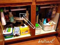 DIY Organization Put a Tension Rod under the sink to hang bottles! #Organization #DIY #TensionRod
