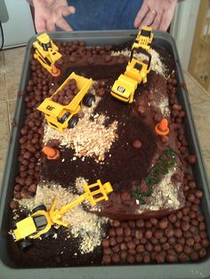 Construction cake... Crushed Oreos, crushed pretzels, coco puffs, and carrot cones.