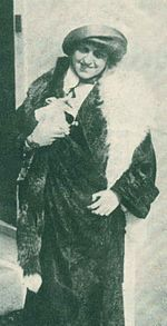Edith Rosenbaum (later Russell), in 1912 shortly after her rescue from the Titanic, carrying the cherished toy pig with which she escaped the ship