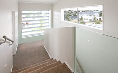 Louvres outside the window adding privacy to the stair case inside