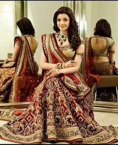 Red Bridal Lehenga in velvet with heavy zari work.