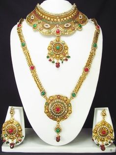 Exclusive traditional Polki Bridal Necklaces comes with Polki Jewellery Accessories http://www.tohfaindia.com/products/jewellery/necklaces/bridal-sets/indian-polki-bridal-jewelry-set-1246.html