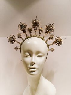 A personal favorite from my Etsy shop https://www.etsy.com/listing/599716850/gold-headdress-catholic-imagination