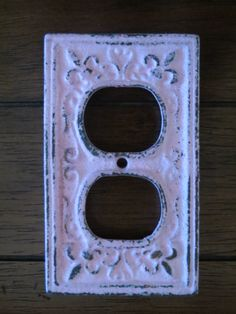Pink Decorative Electrical Outlet Plate /Plug-in Cover/ Fleur de lis/ Bright Cast Iron/ Shabby Chic/Nursery Decor. $8.99, via Etsy.