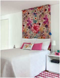 Bring a bit of colour to a white bedroom with a botanical print headboard.