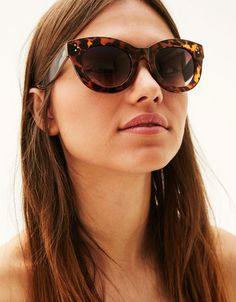Coral cat-eye sunglasses. Discover this and many more items in Bershka with new products every week