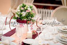 Consiglio n. 1 : scegliete un centrotavola di rose color pastello e bianco, renderanno l'atmosfera calda ed , appunto, romantica.