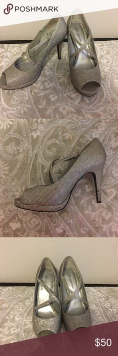 Adrianna Papell silver pumps! Size 8 Worn once for a wedding these heels are in excellent condition and super comfortable. Size 8. Can be worn with silver or gold, since the glitter shimmers both ways. Tiny platform make them super comfortable. Great for a wedding or party! Adrianna Papell Shoes Heels