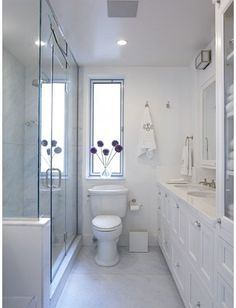 small, white bathroom with glass shower