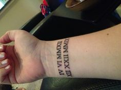 Roman Numeral Wrist Tattoo of my sons birthdays.