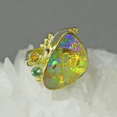 http://www.kalledjewelrystudio.com/collections/jennifer-kalled/products/boulder-opal-ring-16