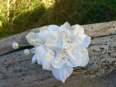 Hey, I found this really awesome Etsy listing at http://www.etsy.com/listing/126308872/starfish-floral-hair-fascinator-beach
