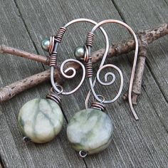 Cool looking earrings: handmade ear wires with serpentine (I think) beads. Like the wire wrap on the wires.
