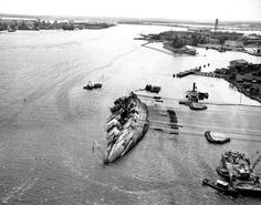 The year was 1943, the month was March, as the U.S. did what it could to righten the previously hit USS Oklahoma just off the shores of Pearl Harbor.