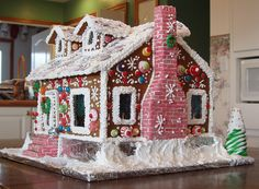 Creative use of candy and colors on this Victorian Gingerbread House designed and decorated by Lynne Schuyler.  Visit www.ultimategingerbread.com for patterns, photo's, recipes and contests.