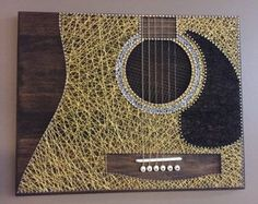Custom Guitar String Art  This detailed Sunburst Guitar string art will be a great gift or addition for the musician in your life. This board measures around 11.25h x 23w and comes with a wall hanger already attached and ready to be mounted to your wall. Wed love to create any customized designs you may have, so feel free to message us with your ideas. Please review our SHIPPING and POLICIES in regards to creation time and returns. Be sure to check out our other products and never hesitate…