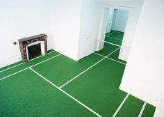 French artist Benedetto Bufalino has created a tennis court over two rooms of a gallery in Dijon, complete with fake grass, white lines and a net across the doorway.