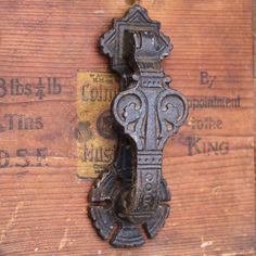 Original antique Victorian door knocker in cast iron. Made by the Kenrick & Sons foundry.