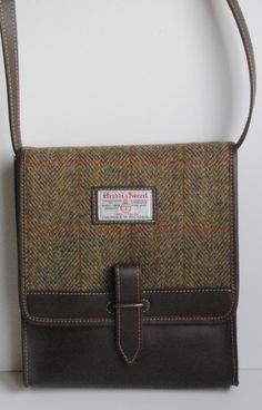 6f13acbbe187 A sturdy Harris Tweed shoulder bag in mustard check tweed with leather trim