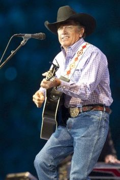 George Strait performs his set at Reliant Stadium during the final concert at RodeoHouston, Houston Livestock Show and Rodeo Sunday, March 17, 2013, in Houston.  Photo by Brett Coomer / Houston Chronicle
