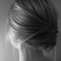 Fishtail braid tucked under to form an elegant updo.