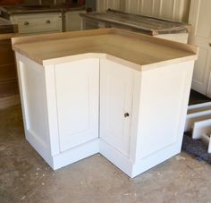Blond Ash top on Swedish Style Corner Unit with Doors.