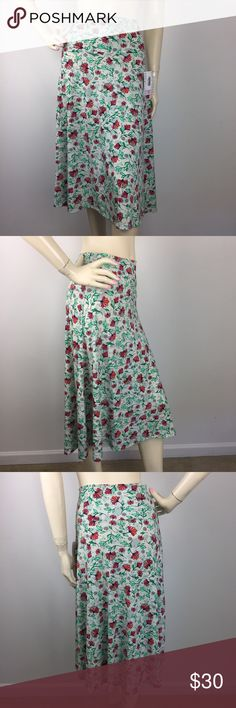 """Lularoe Green Floral Azure Skirt Medium CONDITION: New without tags. MATERIAL: 95% Polyester 5% Spandex (Please note that the measurements are approximate) ALL MEASUREMENTS ARE TAKEN WITH GARMENT LYING FLAT: WAIST: 15"""" HIPS: 24"""" LENGHT: 29"""" LuLaRoe Skirts A-Line or Full"""